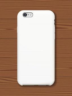 スマートフォンの裏表紙は、木製の背景にモックアップします。