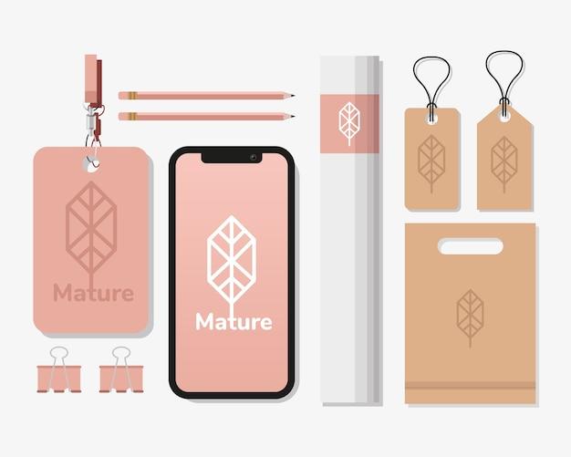 白いイラストデザインのモックアップセット要素のバンドルとスマートフォン