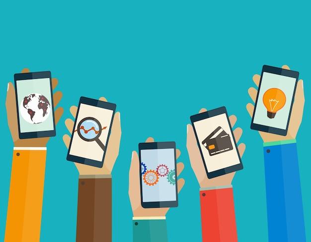 ビジネスアイコンを持つ人々の手にスマートフォン。モバイルのコンセプト。