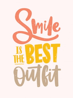 Smile is the best outfit inscription handwritten with elegant calligraphic cursive font. slogan written with colorful letters on light background.
