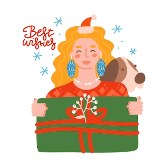 Smiling blondy woman with gift box in her hands cheerful girl with dog holding green present box fla...