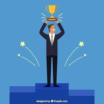 Smiling businessman with a trophy