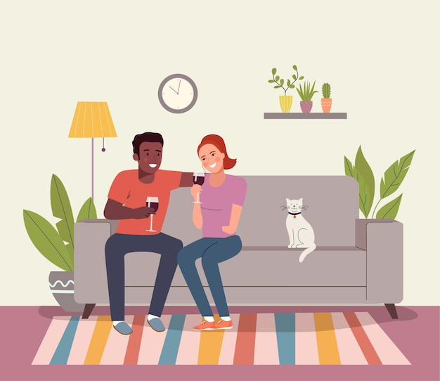 Smiling couple drinking a glass of red wine in their living room