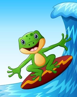 Smiling frog cartoon surfing on big sea waves