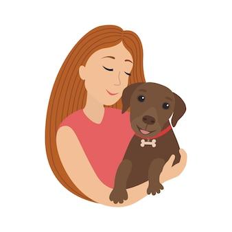 Smiling girl hug a puppy labrador