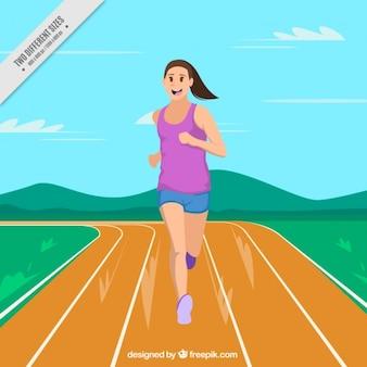 Smiling girl running on the running track
