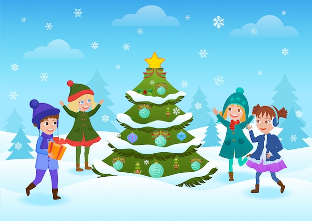 Smiling happy kids having fun standing at decorated christmas tree in winter forest. winter holidays card.