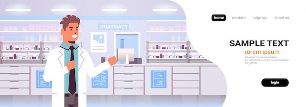 Smiling male doctor pharmacist modern pharmacy drugstore interior medicine healthcare concept horizontal portrait copy space