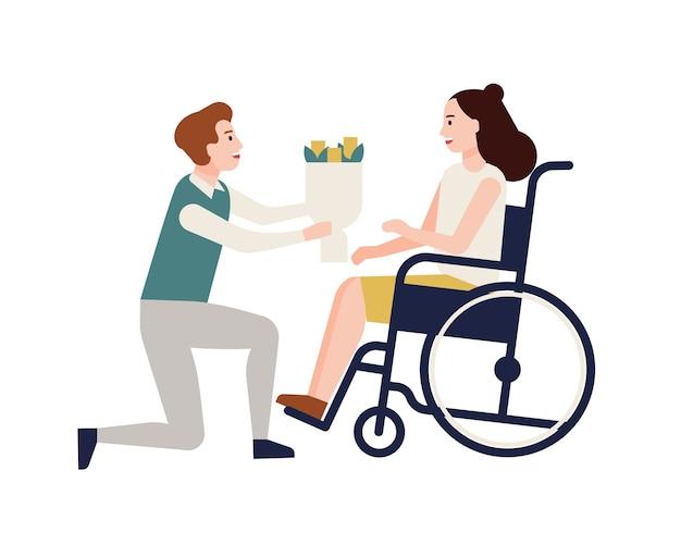 Улыбающийся мужчина дарит букет цветов женщине-инвалиду, сидящей в инвалидной коляске