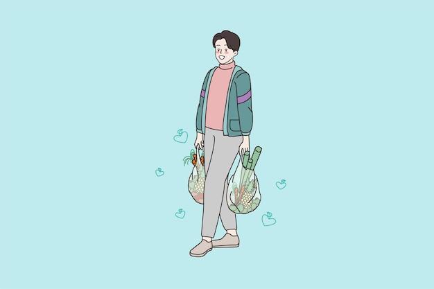 店で買い物袋の食料品と笑顔の男