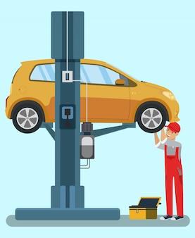 Smiling mechanic repairing yellow car. service station. uniformed worker. automotive parts. car lift. wheel repair