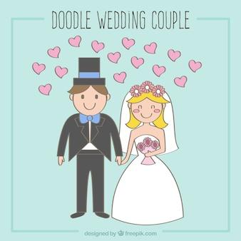 ピンクのハートと笑顔新婚夫婦
