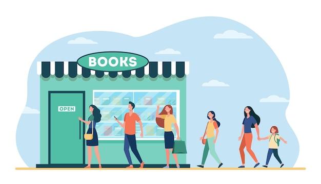 Улыбающиеся люди, стоящие в очереди в книжный магазин.