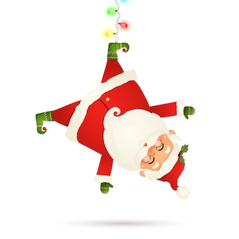 Smiling santa claus cartoon character hanging upside down with garland string of twinkle lights with multicolored bulbs isolated on white background. santa clause for winter and new year holidays.