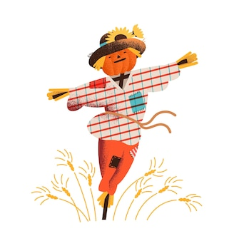 Smiling straw scarecrow dressed in old clothes and hat standing on field with growing crops.