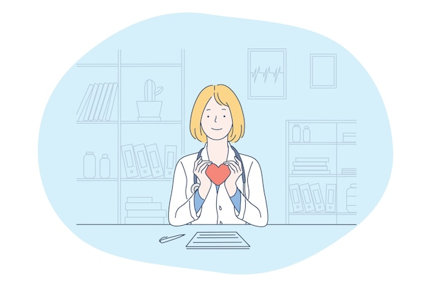 Smiling woman doctor in medical uniform sitting and holding red heart in hands as symbol of healthcare and assistance in medical clinic office