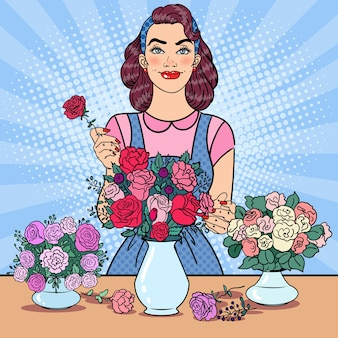 Smiling woman florist making bunch of flowers