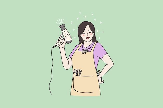 ヘアドライヤーでポーズをとって笑顔の女性美容師