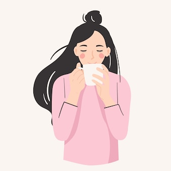Smiling woman holding a mung drinking a cup of coffee