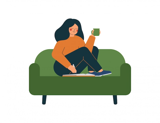 A smiling woman sits on the couch and plans her day