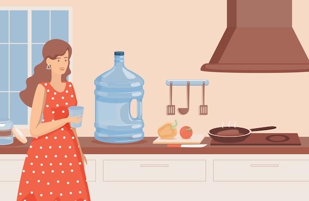 台所に立っている水のガラスと笑顔の女性