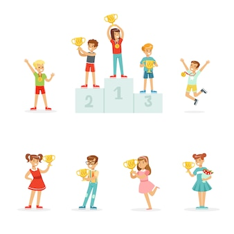メダルと優勝カップを祝う笑顔の若い男の子と女の子