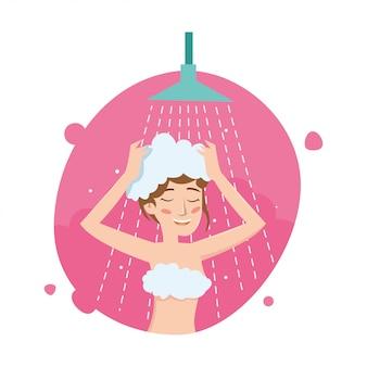 Smilling women wash head in the bathroom