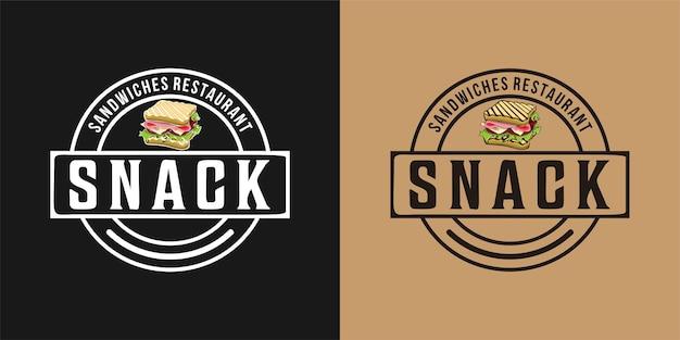 スナック、ハム、チーズ、トマト、レタス、トーストしたパンのロゴのサンドイッチ