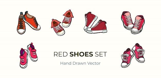 スニーカーの靴のペアが分離されました。赤い靴の手描きの背景イラストセット。
