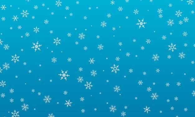 Снежный фон. зимний снегопад. белые снежинки на голубом небе. рождественский фон. падающий снег.