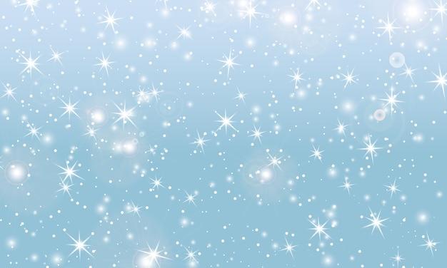 雪の背景。冬の降雪。青い空に白い雪片。クリスマスの背景。雪が降る。