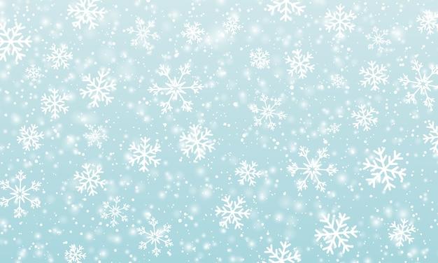 Снежный фон. зимний снегопад. белые снежинки на голубом небе.