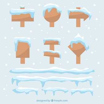 Snow cap set on wooden signs