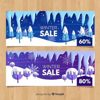Snow-covered tree winter sale banner
