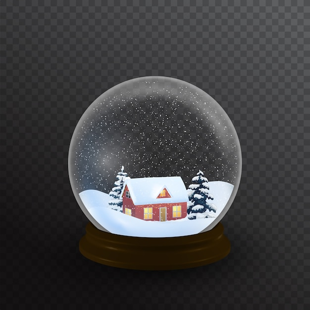 Snow globe with house and christmas tree.