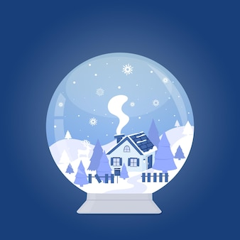 Snow globe with house in the forest among the mountains and firs winter landscape
