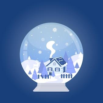 Снежный шар с домиком в лесу среди гор и елей зимний пейзаж
