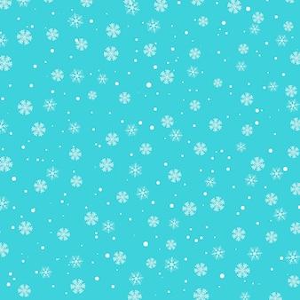 雪のパターン。青い背景に白い雪。