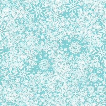 Snow seamless pattern. white snowflakes on blue background. falling snow.