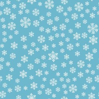 雪のシームレスパターン。青い背景に白い雪。雪が降る。