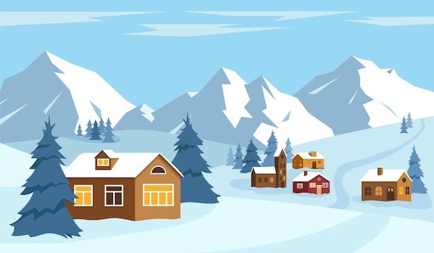 雪の冬の風景雪の山と小さな村