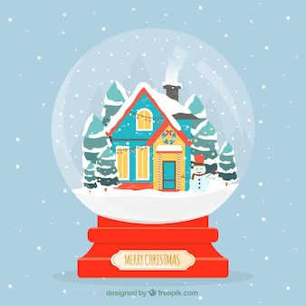 Snowball background with houses in flat design