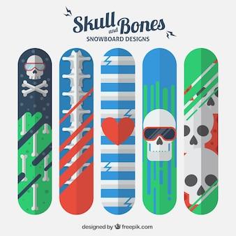 Snowboard designs with skulls and bones