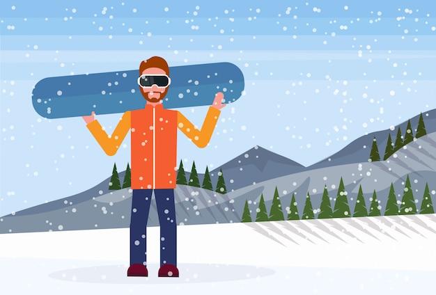 Snowboarder man holds snowboard