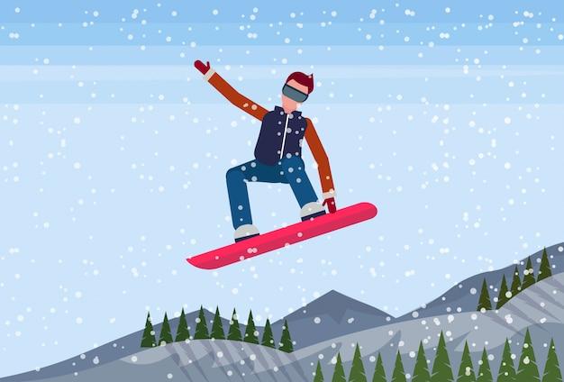 Snowboarder man jumping