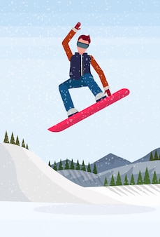 Snowboarder man sliding down the mountain