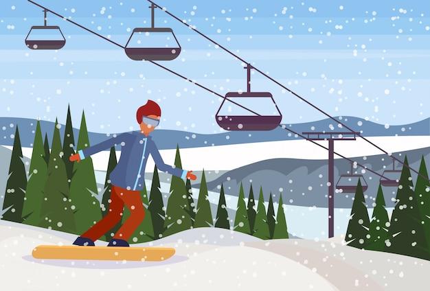 山を滑り落ちるスノーボーダー男