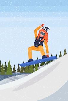 Snowboarder woman sliding down the mountain
