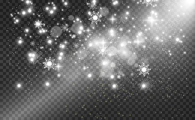 降雪。透明な背景に雪がたくさん。冬の背景。空から落ちてくる雪。
