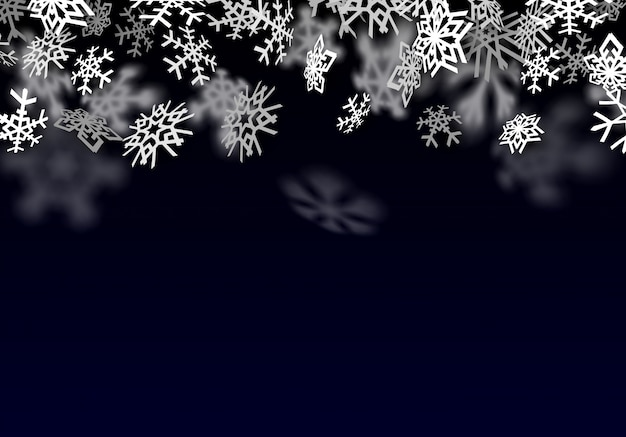 Snowfall background. falling transparent snow with big snowflakes